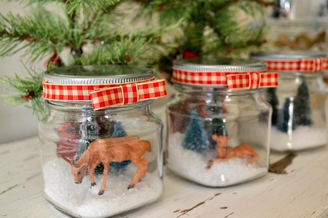 small glass jars with snow scene deer, trees, and deer. www.homeroad.net