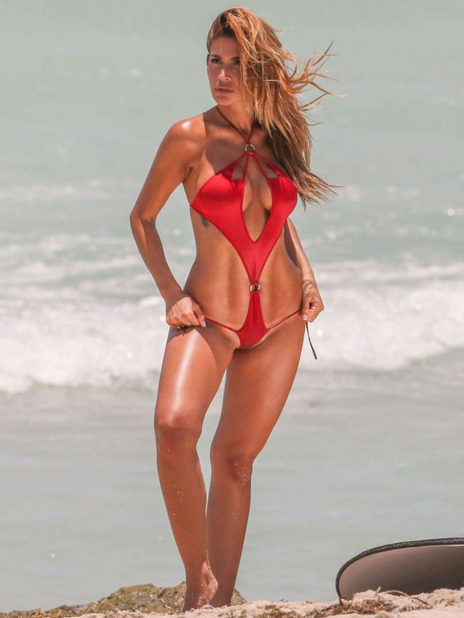 Juliana Proven smoulders in cutout swimsuit for beach photoshoot