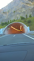 a car heading to a tunnel entrance in Spain.