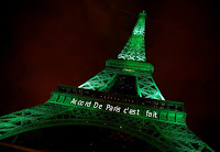 The Eiffel tower is illuminated in green with the words ''Paris Agreement is Done'', to celebrate the Paris U.N. COP21 Climate Change agreement.    (Credit: Reuters/Jacky Naegelen)