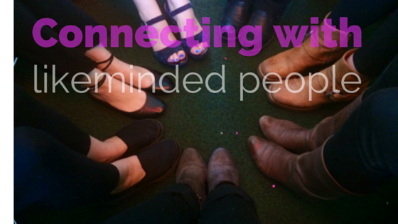 Image of feet in a circle, text reads 'connecting with likeminded people'