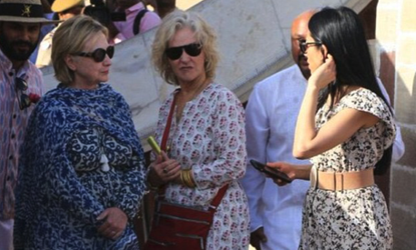 It takes a village: Hillary Clinton layers a scarf, shawl and custom kurta with extra-long sleeve to hide broken wrist after hotel tub fall while touring Jaipur