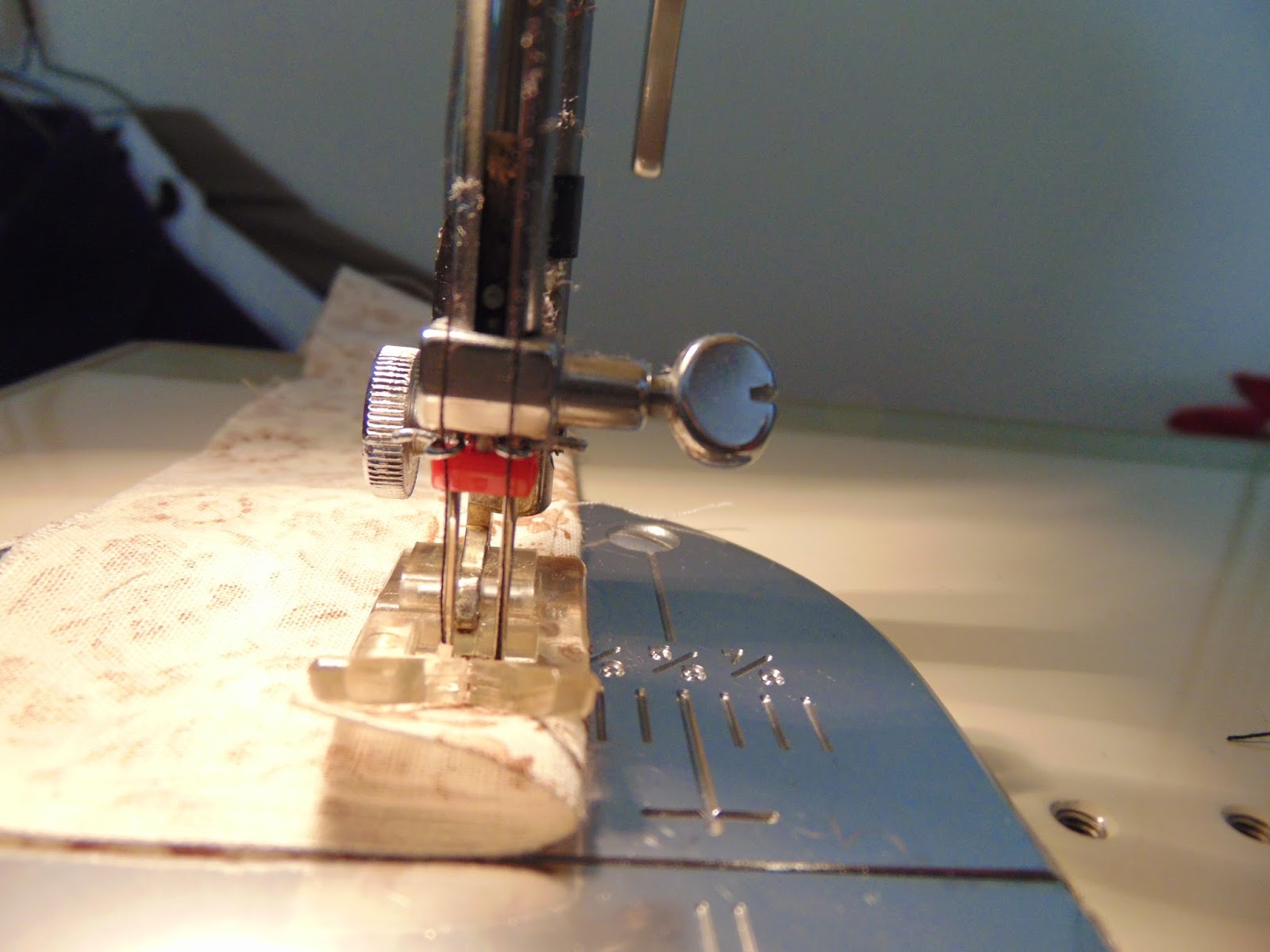 Close up of threaded double needle in sewing machine