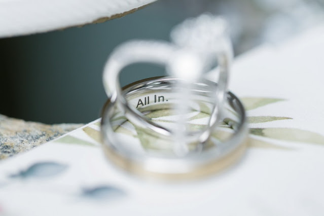 engagement ring and wedding band with saying