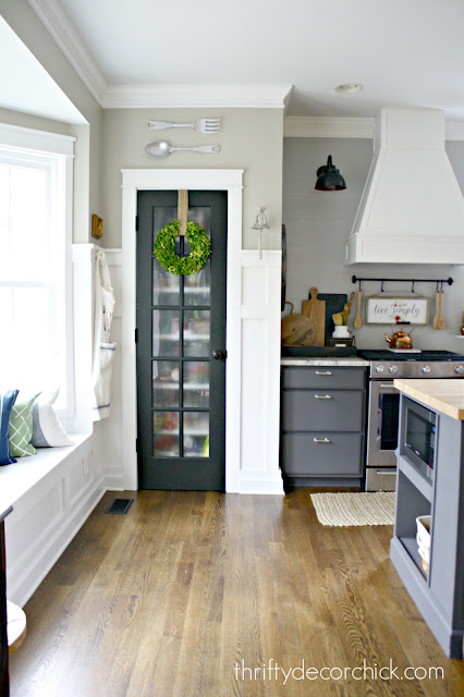 Black pantry door with glass
