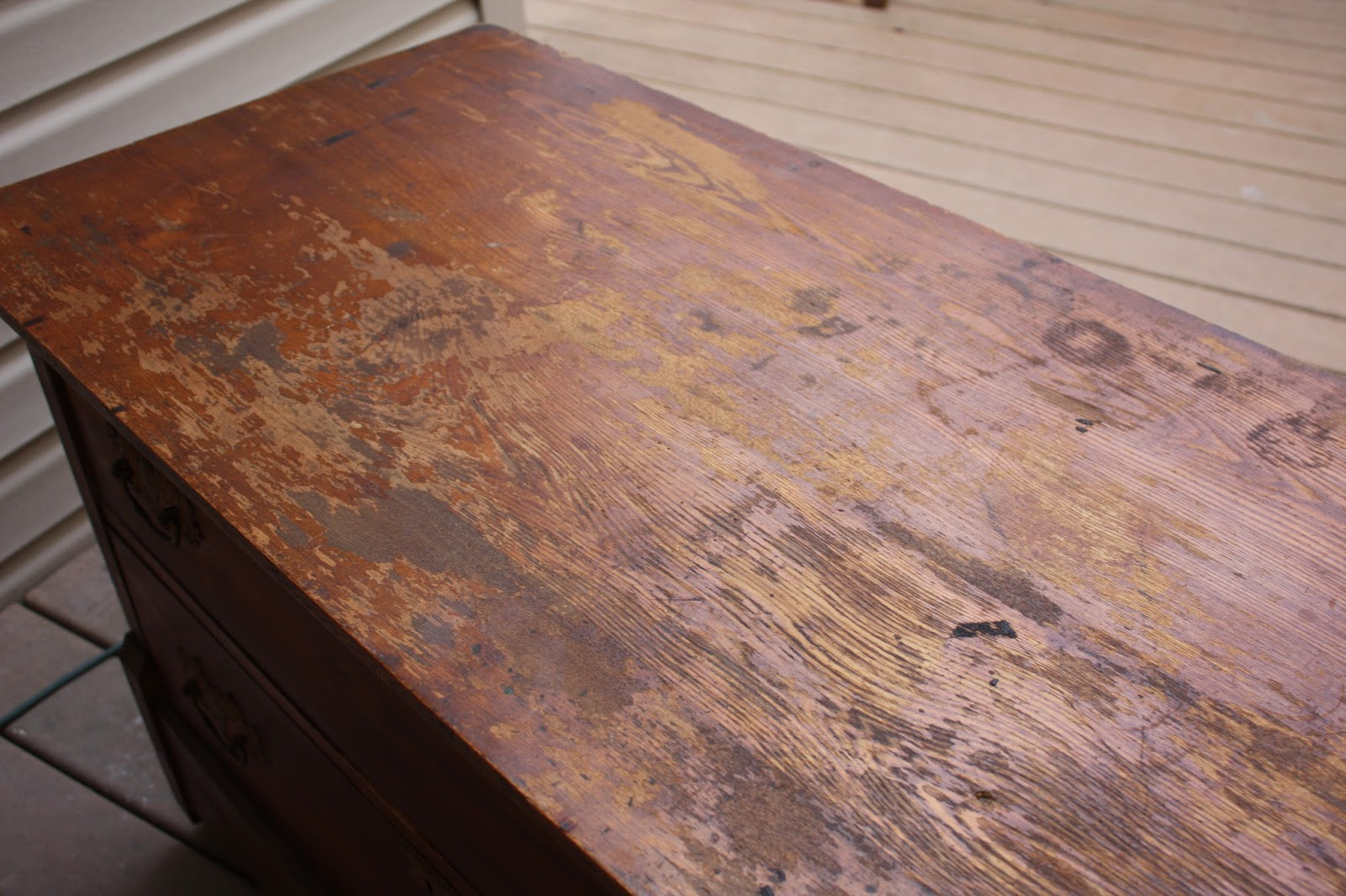 Antique dresser with poor finish