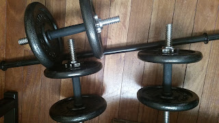 Three black shaded dumbbels
