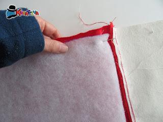 imbastitura dell'imbottitura della calza natalizia