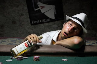 Poker player drunk at the table and staring at the ceiling.