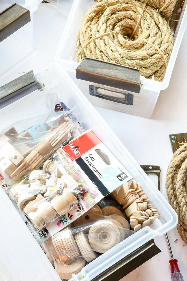 Organizing craft supplies in storage bins
