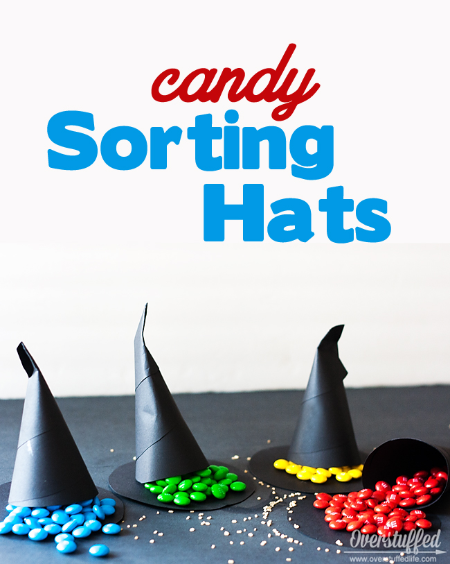 Make fun candy sorting hats for your Harry Potter party. When the cones are opened, the candy color tells them which house they are sorted into. #overstuffedlife