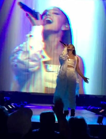 Ariana Grande performing on stage
