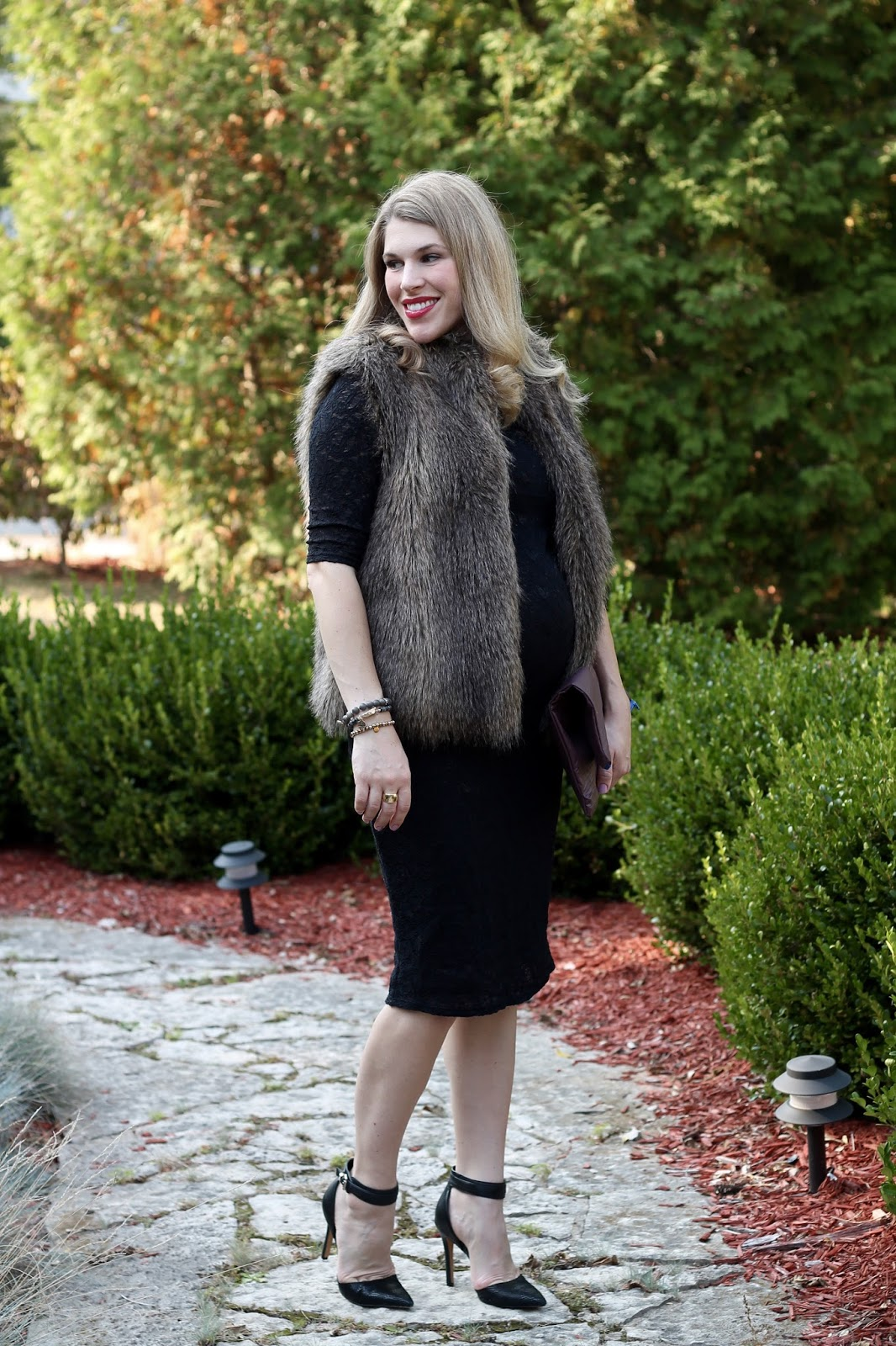 fall wedding look, black lace dress, fur vest, burgundy clutch