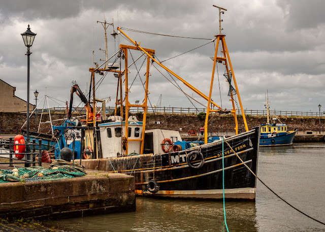 Photo of a fishing boat in Maryport Harbour at high tide just after Storm Hector
