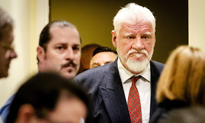 """فيديو لحظة تناول """"مجرم حرب"""" البوسنة  السم  وموته خلال دقائق"""