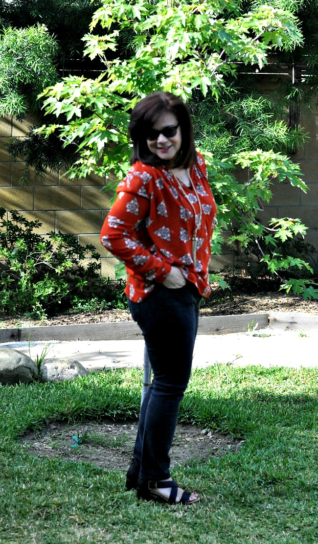 red blouse and black jeans