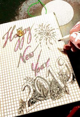 zdjęcie własnoręcznie wykaligrafowane życzenia , czarnym flamastrem napis : Happy New Year 2019