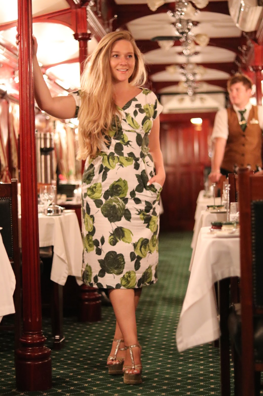 Katie Heath wearing green and white dress aboard Rovos Rail, South Africa