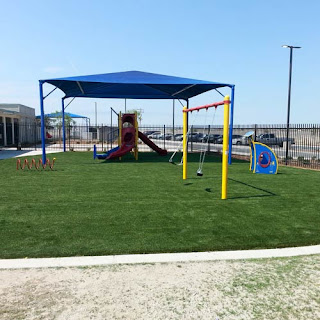 Greatmats playground turf surface with shade structure