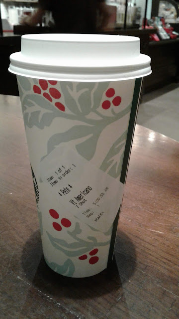 7 Shot Starbucks Americano cup with order label