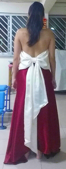 Back view of the wine red evening gown with a huge off white ribbon bow at the back
