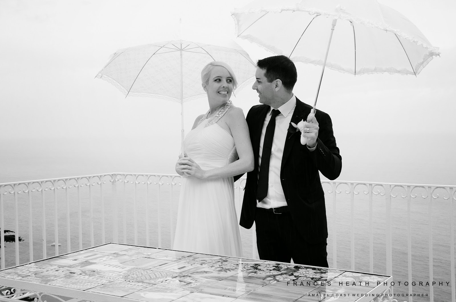 Bride and groom portrait with umbrellas in Positano