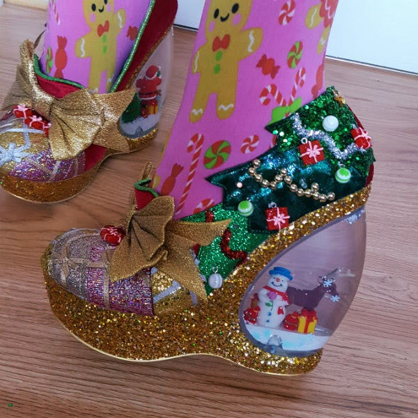 closeup of snowman and reindeer inside snowglobe heeled shoes