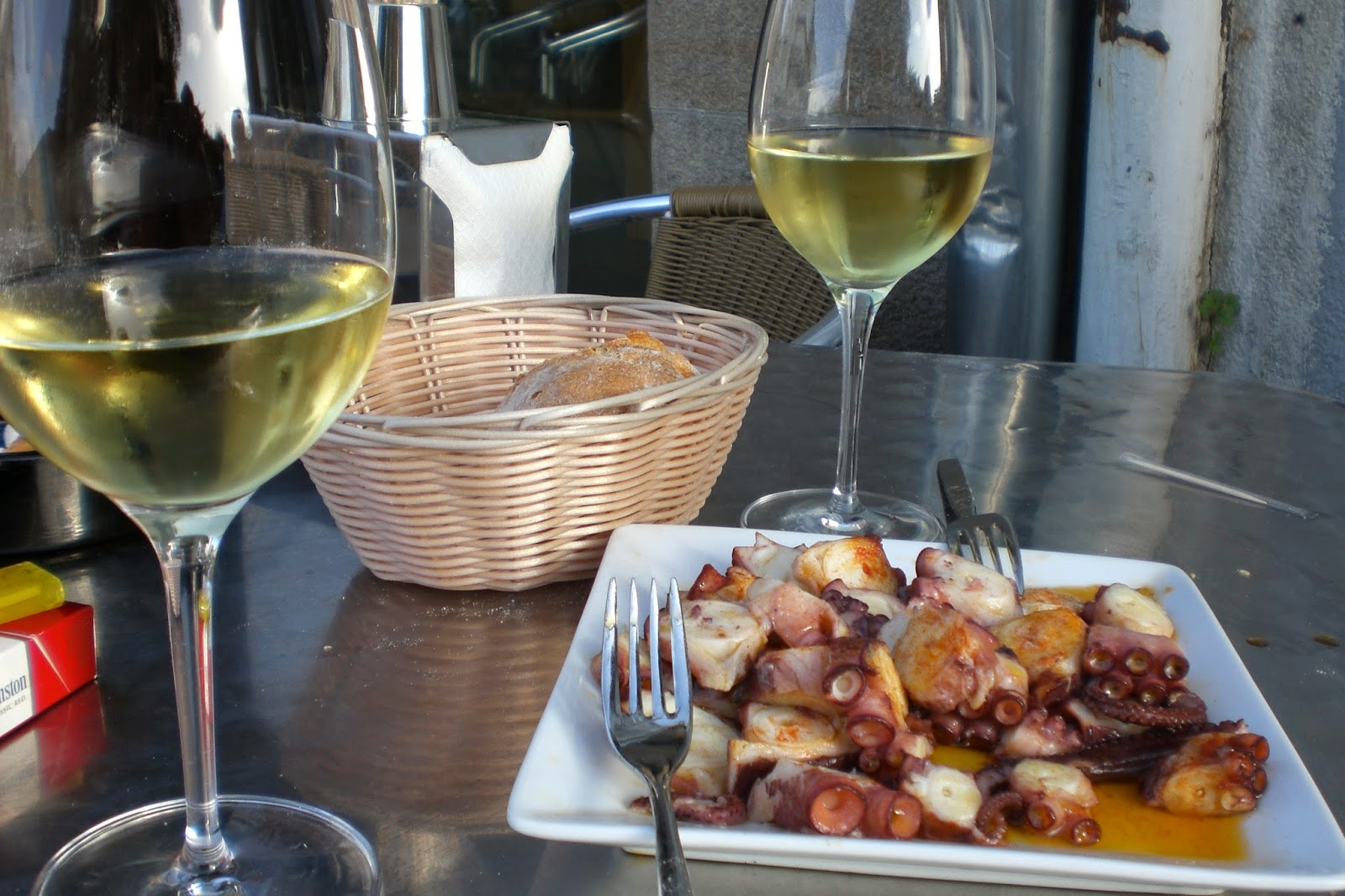 When in Santiago de Compostela do as the Galician's do and try a plate of pulpo washed down with a glass of wine.
