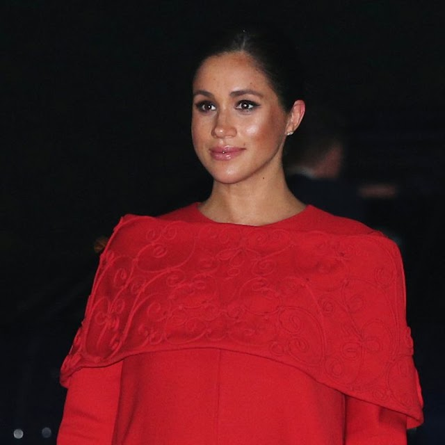 Meghan Markle Just Arrived in Morocco Wearing a Striking Red Valentino Cape Dress.