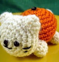 http://www.ravelry.com/patterns/library/tangerine--orange--clementine-amigurumi-cat