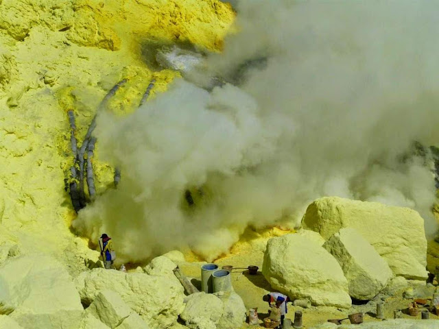 Sulfur Miners Story Traditional In Mount Ijen , East Java , Indonesia