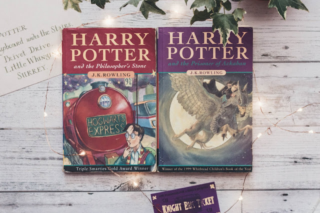 Harry Potter and the Philosophers Stone and Harry Potter and the Prisoner of Azkaban by J.K Rowling surrounded by fairylights and ivy
