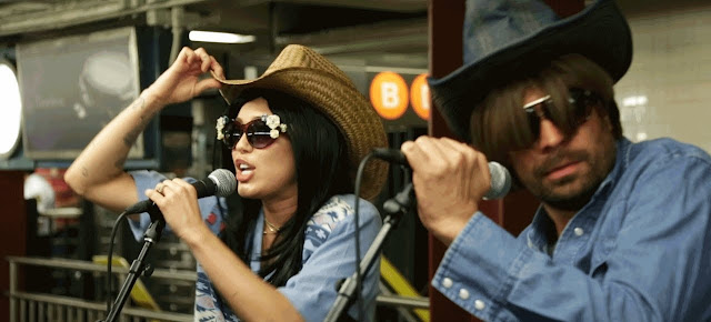 Still Image while Miley Cyrus and Jimmy Fallon Performing in NYC Subway in Disguise