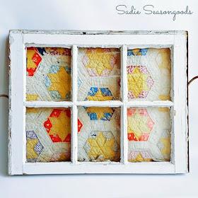 vintage quilt in a salvaged window