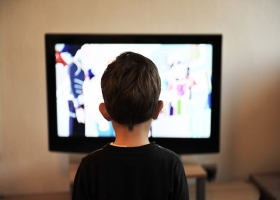 A child watching TV.