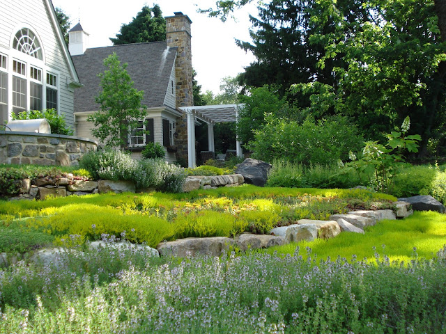 The private residence of a CEO is built from the ground up to provide abundant gardening opportunities for the owners.