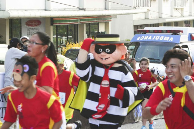 Hamburglar running with the McHappy Day Fun Run 2012 runners