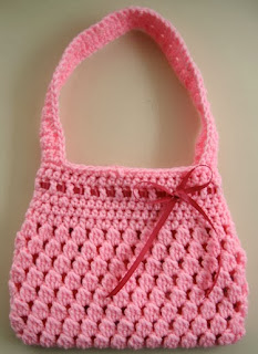 http://translate.googleusercontent.com/translate_c?depth=1&hl=es&rurl=translate.google.es&sl=en&tl=es&u=http://speckless.wordpress.com/2010/11/19/free-crochet-pattern-bobble-licious-bag/&usg=ALkJrhjPr5vuJQiUXYFpt6FdrB2SSpYqng