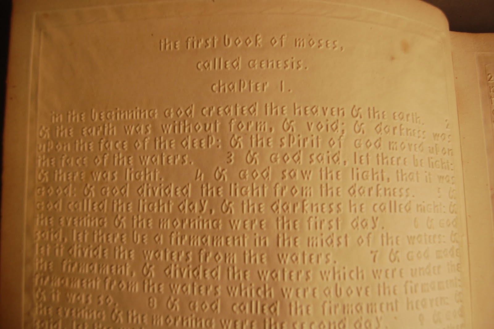 close up of raised letters on Bible for the blind