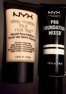 A thick wide black triangular clear bottle with a yellow-white liquid inside with NYX on the outside in big bold font with stay matte not flat on the front in smaller font next to a thin tall black plastic triangluar bottle with a circular black lid that says NYX in large white font with Foundation Mixer in smaller font on a bright background.