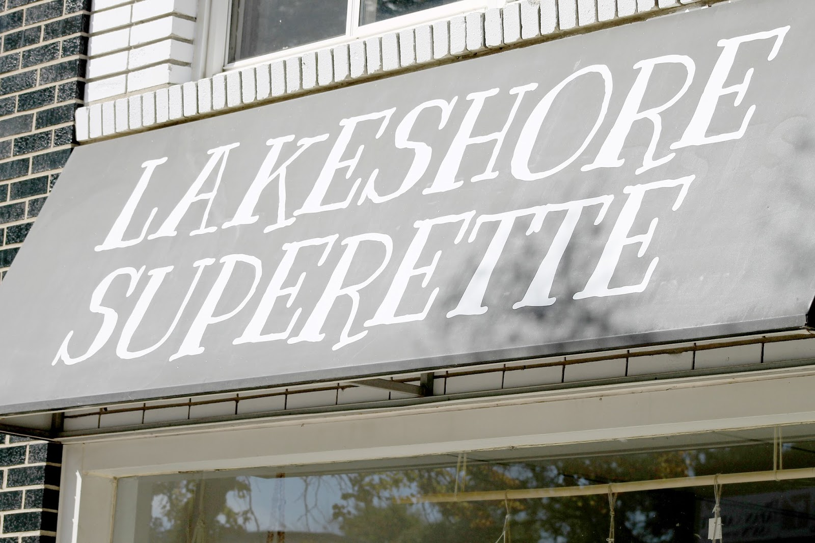 Lakeshore Superette in Mississauga storefront store window display