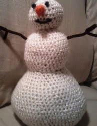 http://www.ravelry.com/patterns/library/stuffed-snowman-decor-doll