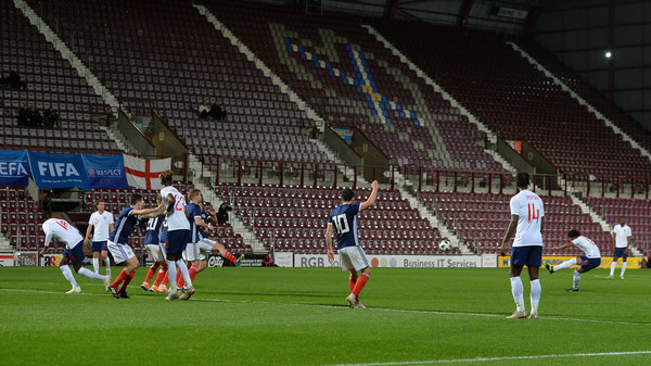 Reiss Nelson of England U21 scores his team's first goal during the 2019 UEFA European Under-21 Championship Qualifier match between Scotland U21 and England U21 at Tynecastle Stadium on October 16, 2018 in Glasgow, Scotland
