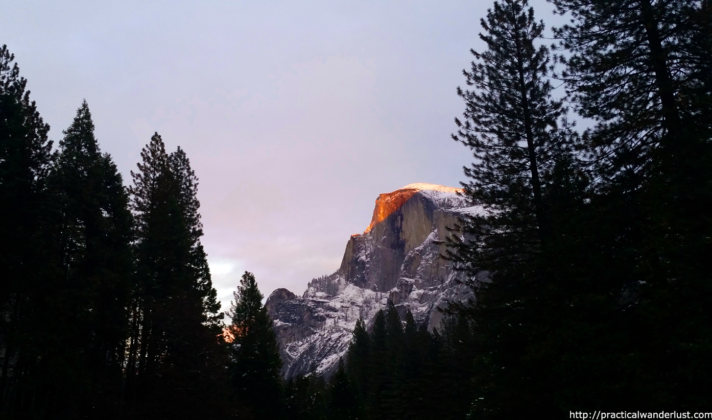 A ray of sun hitting Half Dome at Sunset in Yosemite Valley, Yosemite National Park, northern California. Yosemite is a perfect weekend trip from the San Francisco Bay Area.