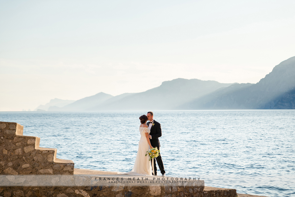 Bride and groom on Amalfi coast beach