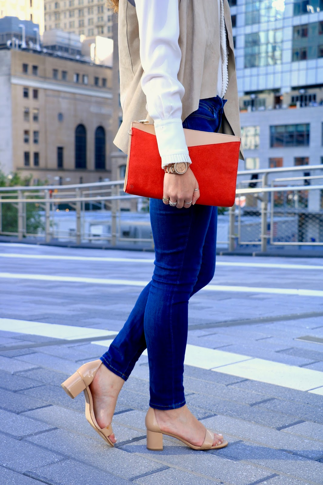 Nyc fashion blogger Kathleen Harper in skinny jeans and heels
