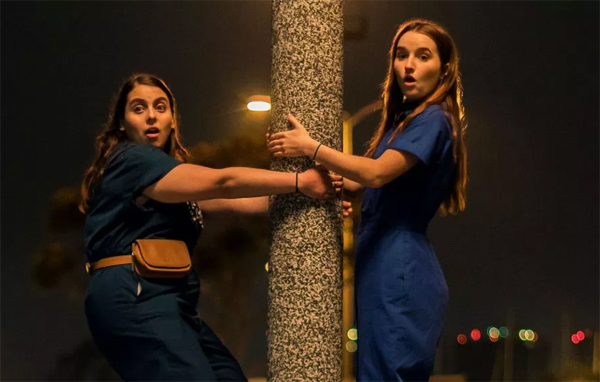 Beanie Feldstein as Molly and Kaitlyn Dever as Amy, in matching outfits, in 'Booksmart'
