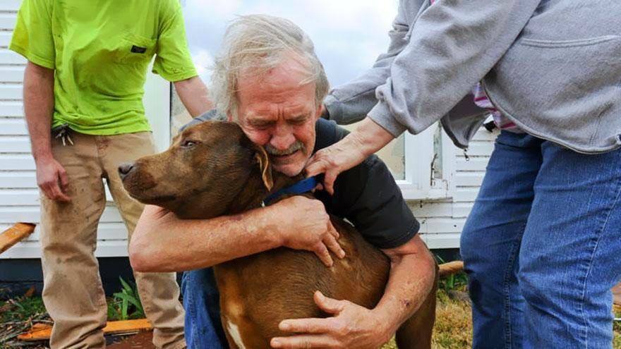 30 of the most powerful images ever - Greg Cook hugs his dog Coco after finding her inside his destroyed home in Alabama following the Tornado in March, 2012