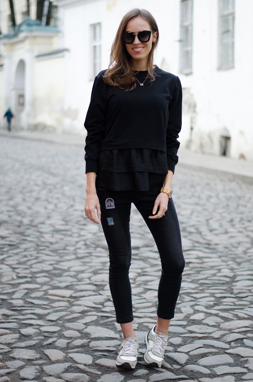 kristjaana mere black minimalist spring outfit jeans and sweater