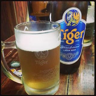 On Tiger beer, Singapore Sling, and Bak Kut Teh